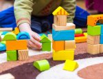 depositphotos_102635014-stock-photo-small-child-playing-with-wooden