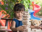 girl-kid-playing-jenga-games_40923-70